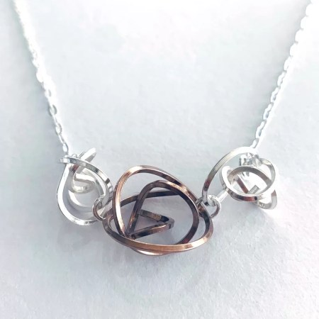 Victoria Johnson - three tangle pendant with rose gold.