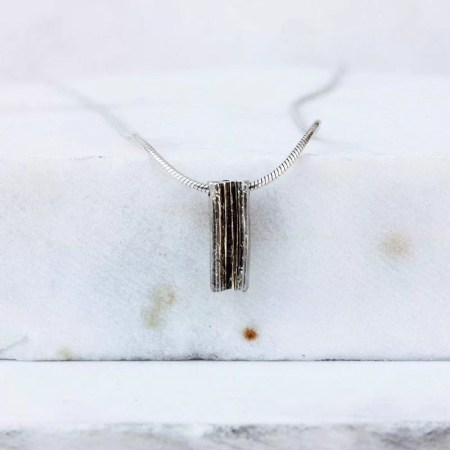 Eleni Koumara - small silver bar necklace.