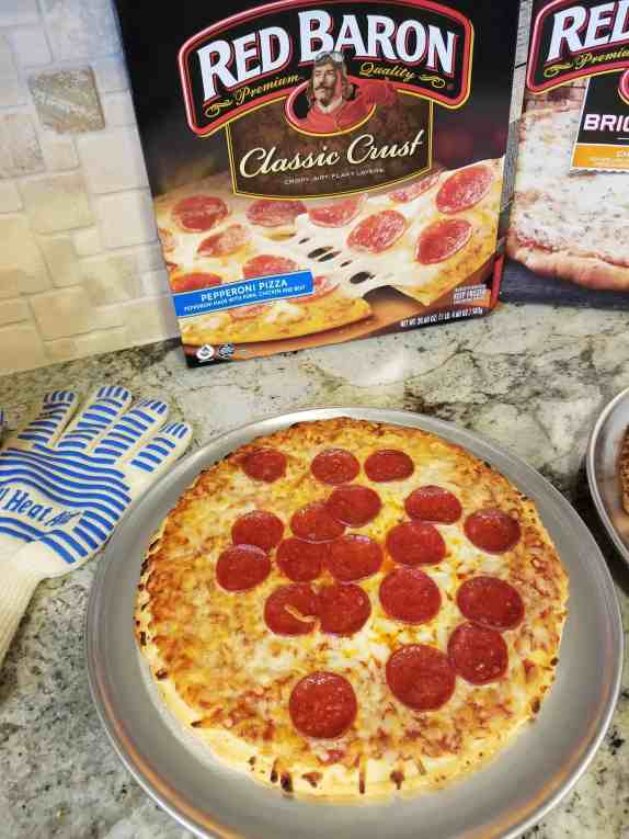 Love that Red Baron pepperoni and so does the whole family! Use this tip and more to reduce summer chaos at Made In a Pinch. Red Baron pizza box with cooked pizza and oven glove.