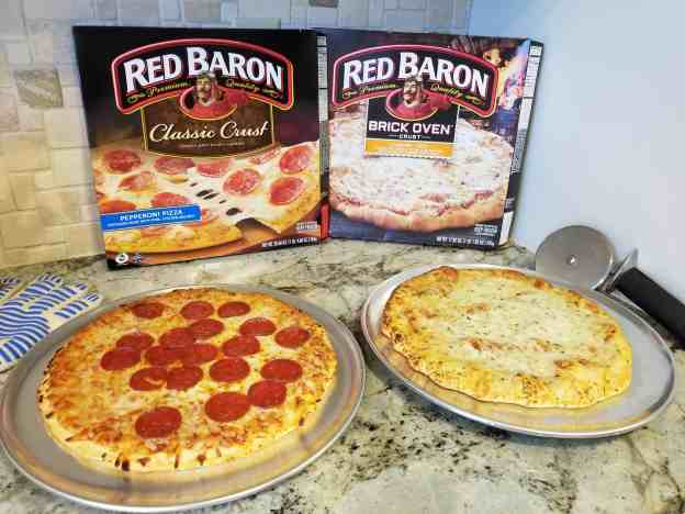 With so many flavors, pizza is easily a family favorite and makes everyone happy. Check out Red Baron pizza and more simple tips for reducing summer chaos at Made In A Pinch. Red Baron boxes with cooked pizzas.