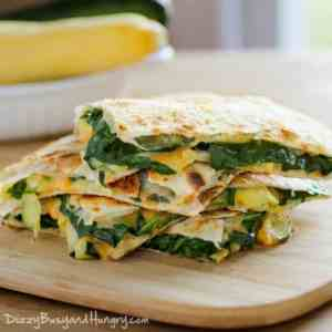 cheesy zucchini spinach quesadillas are hearty and delicious! Get the recipe at Made in a Pinch and follow us on Pinterest!