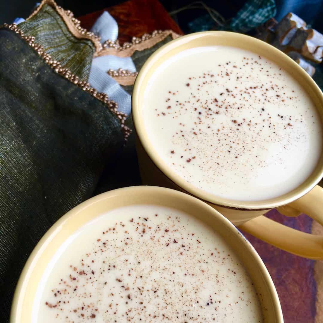 Smooth, creamy non alcoholic eggnog in mugs