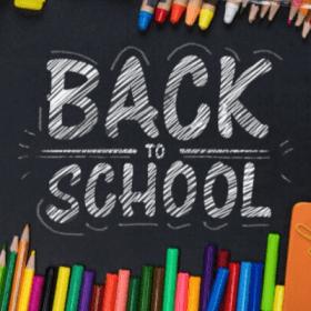 Blackboard with school supplies
