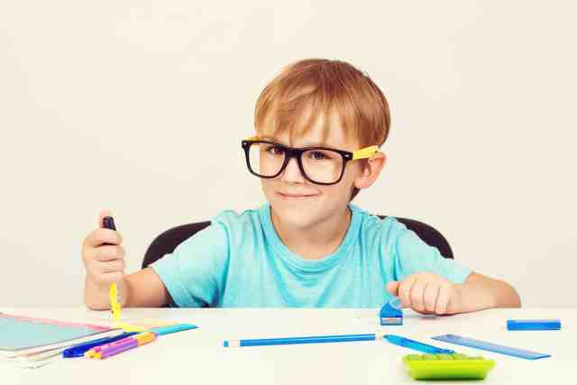 fun educational activities like what this boy with glasses is doing