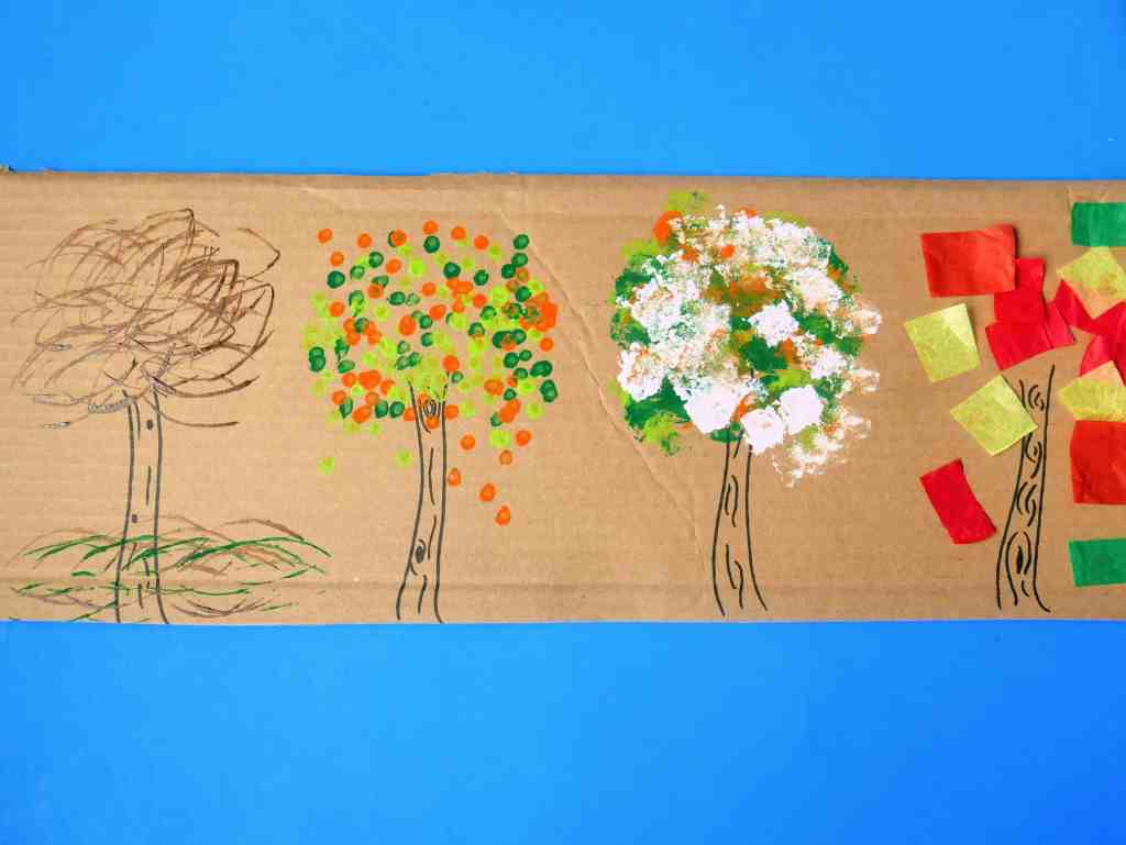 four seasons tree craft for kids using 4 different methods for painting on the leaves.