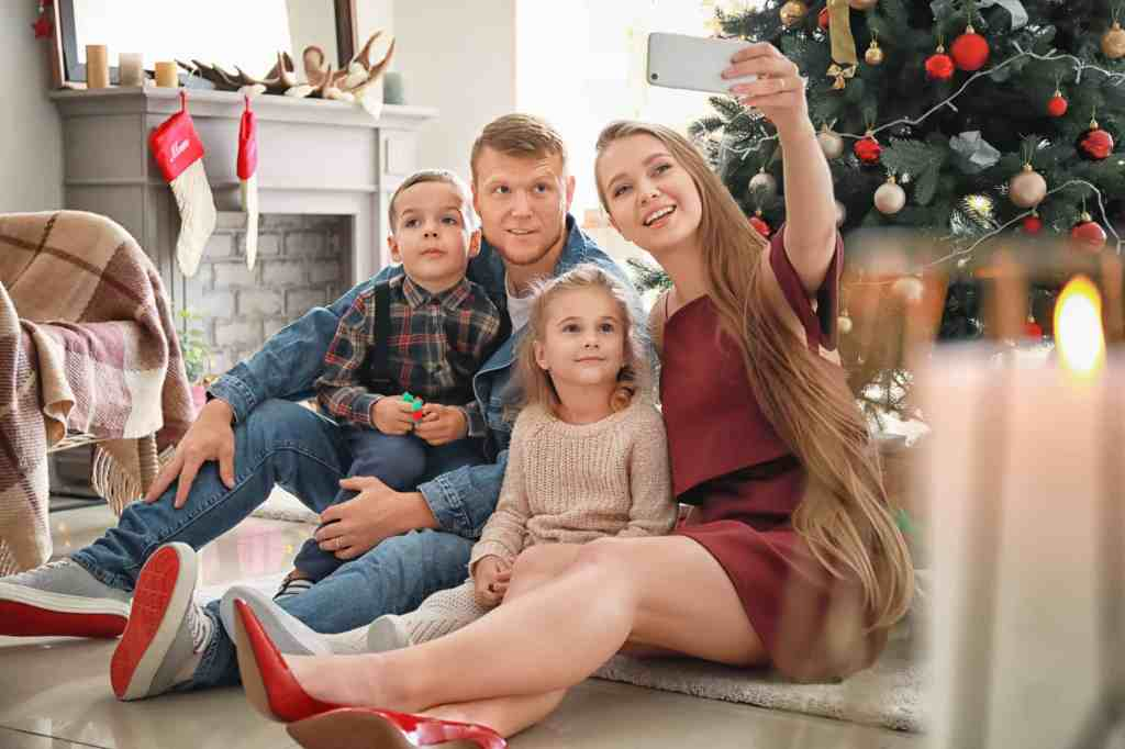 family using zoom to connect for the holidays this year is just one of many holiday party ideas that are different but special.