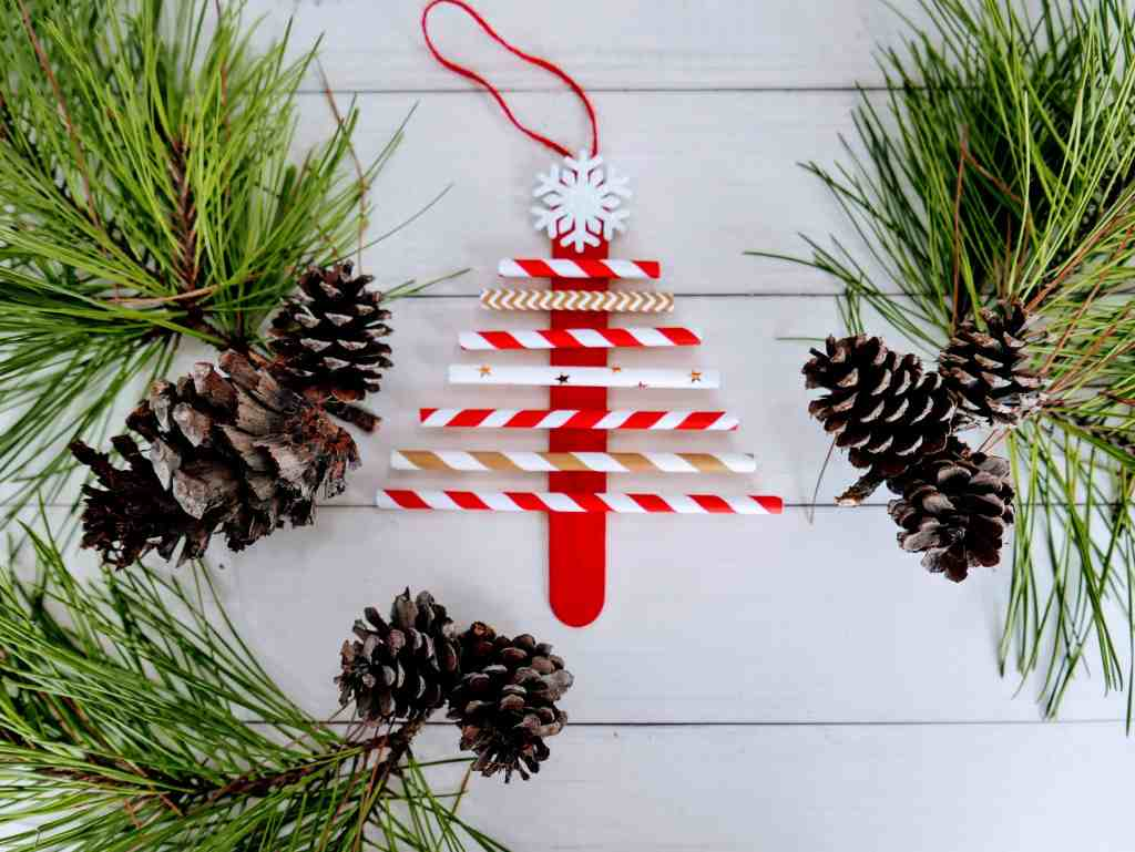 paper straw Christmas tree craft ornament with greenery and pinecones