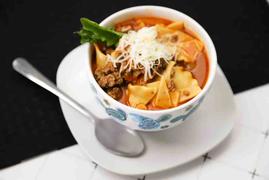 Instant pot lasagna soup in a bowl with a spoon