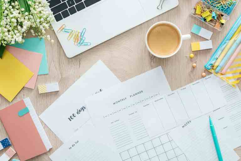 planners for moms - all materials on a desk with laptop and cup of coffee