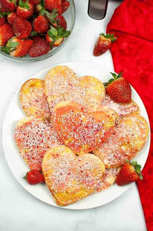 plate of heart-shaped homemade strawberry pop tarts