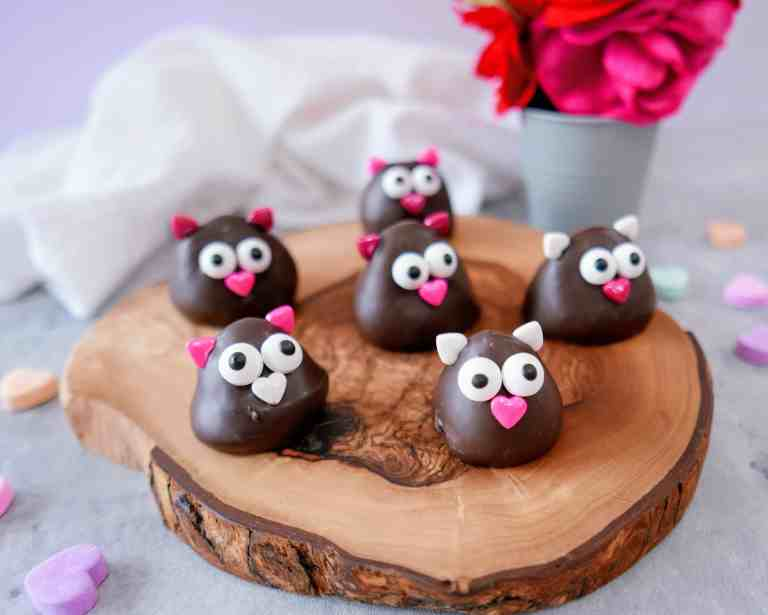 Valentine's Day lovebirds - chocolate-dipped strawberries on a wood tray