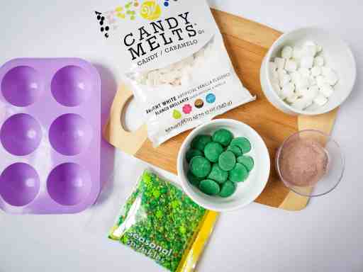 ingredients and supplies for St. Patrick's Day DIY hot cocoa bombs