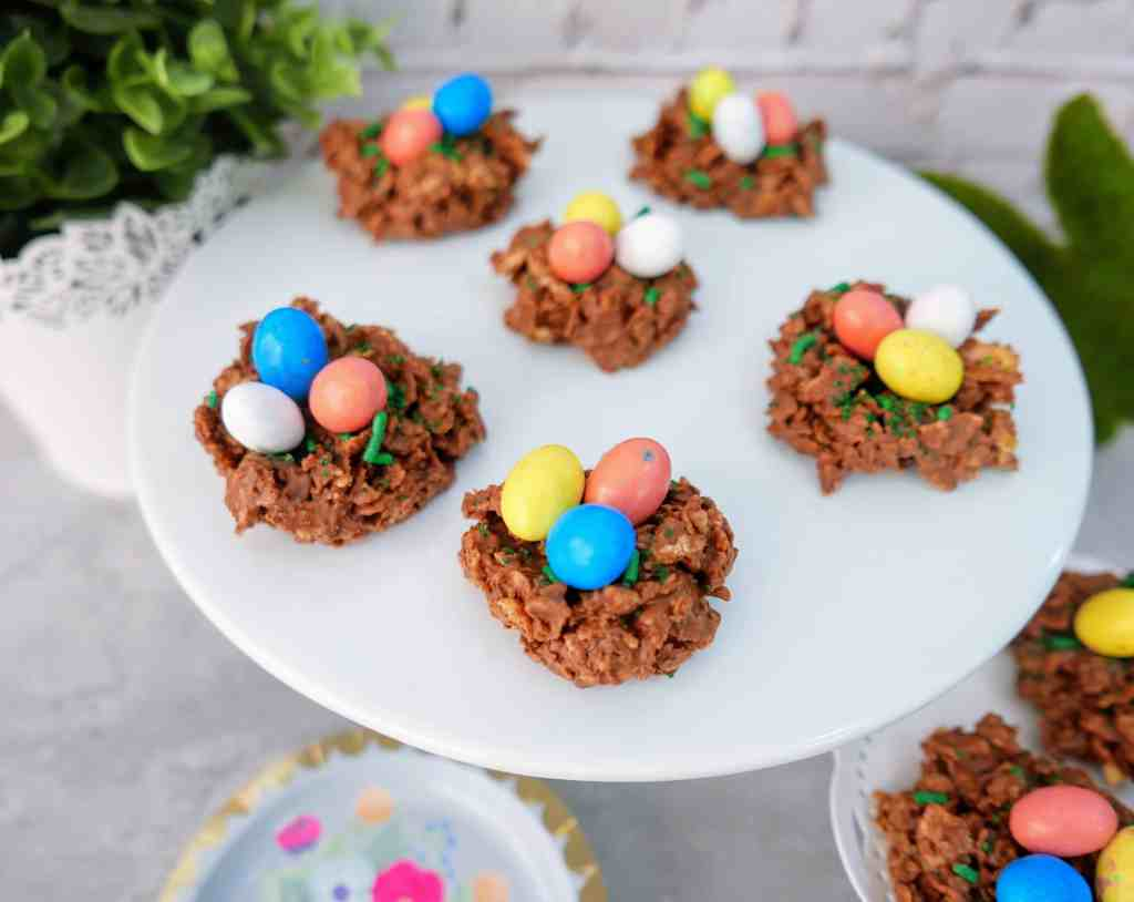 Chocolate and Peanut Butter Bird's Nest Cookies - a sweet Easter treat that is quick, easy, and FUN to make! These bird's nest treats have a twist from the typical way of making them and are kid-approved and lip-smackin' good!! These Easter Bird's Nest cookies are a traditional Easter recipe with a fun new twist. Plus they're SO CUTE! #Easter #birdsnest #nobake #cookies #dessert #treats #holidays
