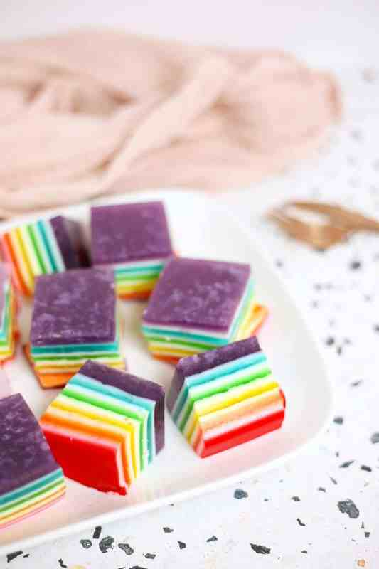 rainbow jello squares on a plate