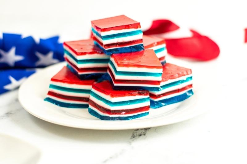 stacked red white and blue jello squares on a plate