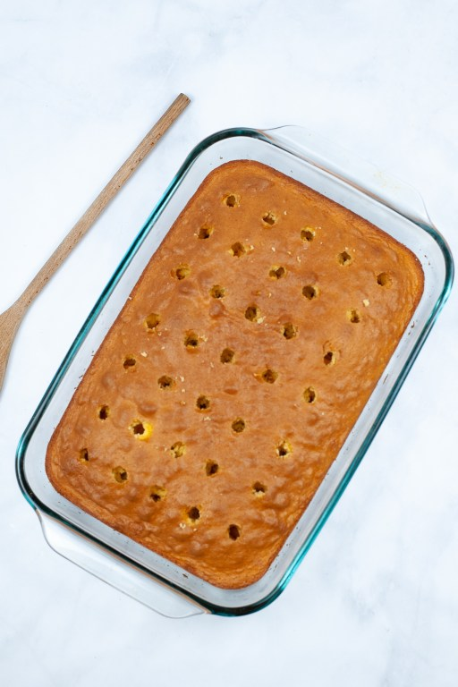 baked cake with holes poked in it