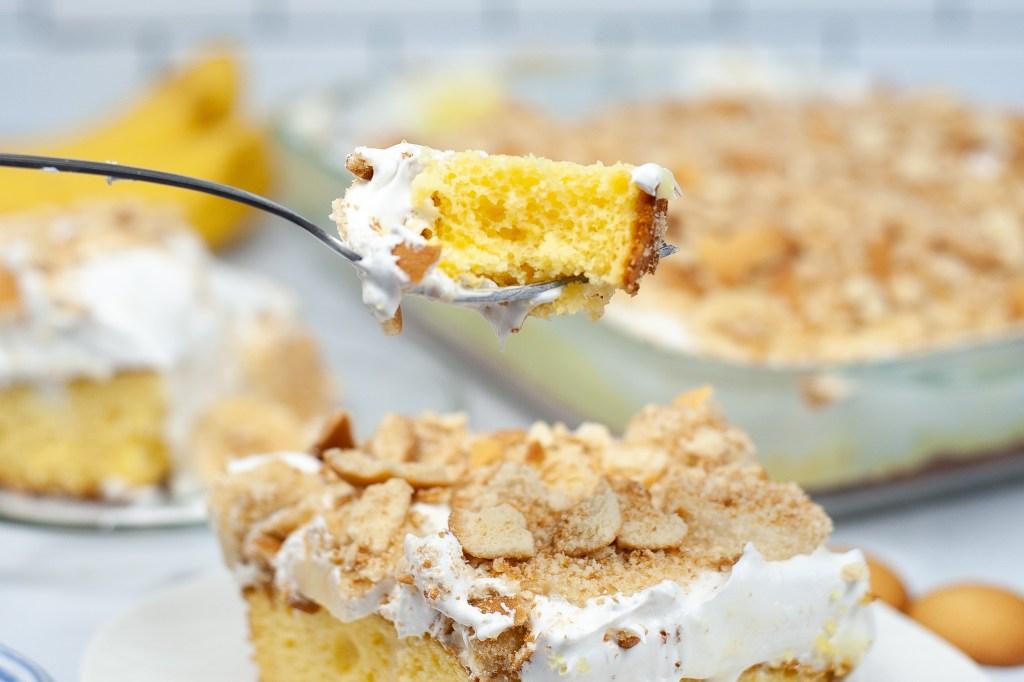 closeup of bite of banana pudding poke cake