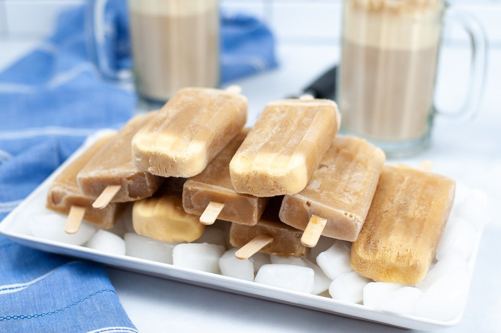frozen root beer pops stacked on a tray