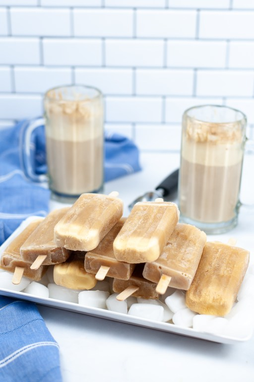 stacked root beer float popsicles on a tray