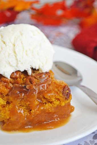 pumpkin upside down cake on a plate with ice cream