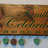Family Celebration Board Green Text Brown Design