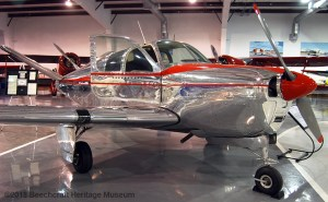 Bonanza airplane with highly polished, reflective finish.