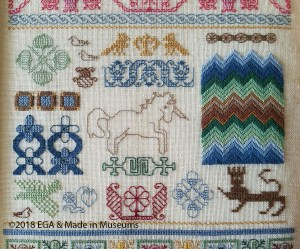 Close-up of stitches in one band of Harold Gordon's band sampler