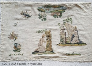 Mourning sampler as indicated by the harp scene