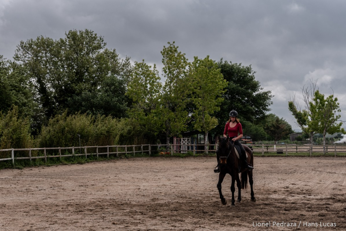 Villeneuve de la Raho, April 17, 2020, equestrian center. Close to the public since March 17, 2020 following the containment established during the COVID19 pandemic. Lucie rides a horse. Maintaining the animal's physical condition is imperative for its health and for resuming equine lessons at the end of confinement. Villeneuve de la raho, 17 avril 2020, centre equestre. Fermer aux public depuis le 17 mars 2020 suite aux confinement instaure lors de la pandemie du COVID19. Lucie monte un cheval. Le maintien de la forme physique de l animal est imperative pour sa sante et pour une reprise des cours equins a la fin du confinement.