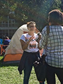 """We want the administration to divest and we'll be here until they do,"" said Sara O'Brien, a fourth year political science major [pictured getting interviewed by another journalist]. ""Climate change is just one of the things the administration should be divesting from."""