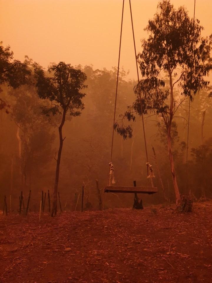 Garden swing is still in orange bushfire haze.