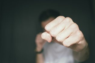 Someone in a fighting stance, with a fist in your face