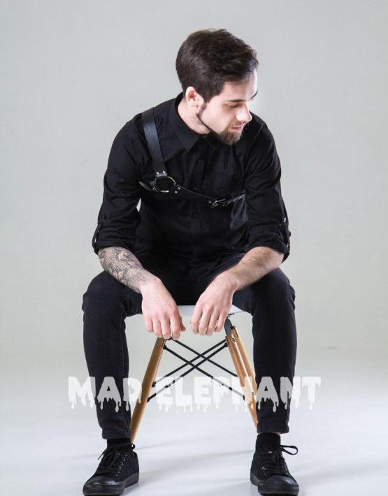man in asymmetrical leather harness