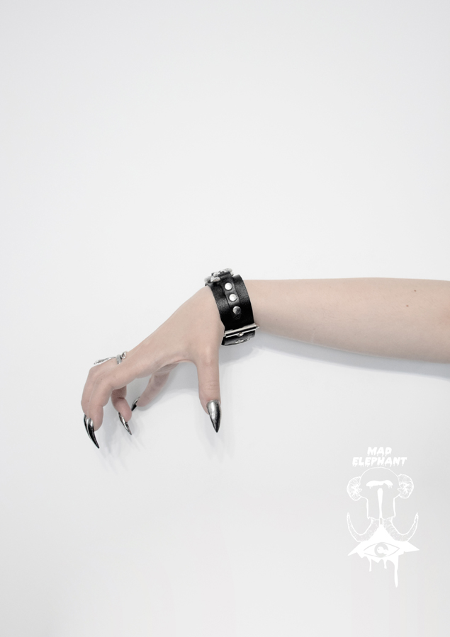 leather wrist accessory with serpent symbol