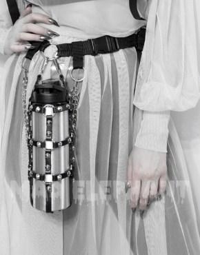 leather bottle harness on the belt looks like lantern