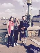 Mady, Inès, and bagpipe player
