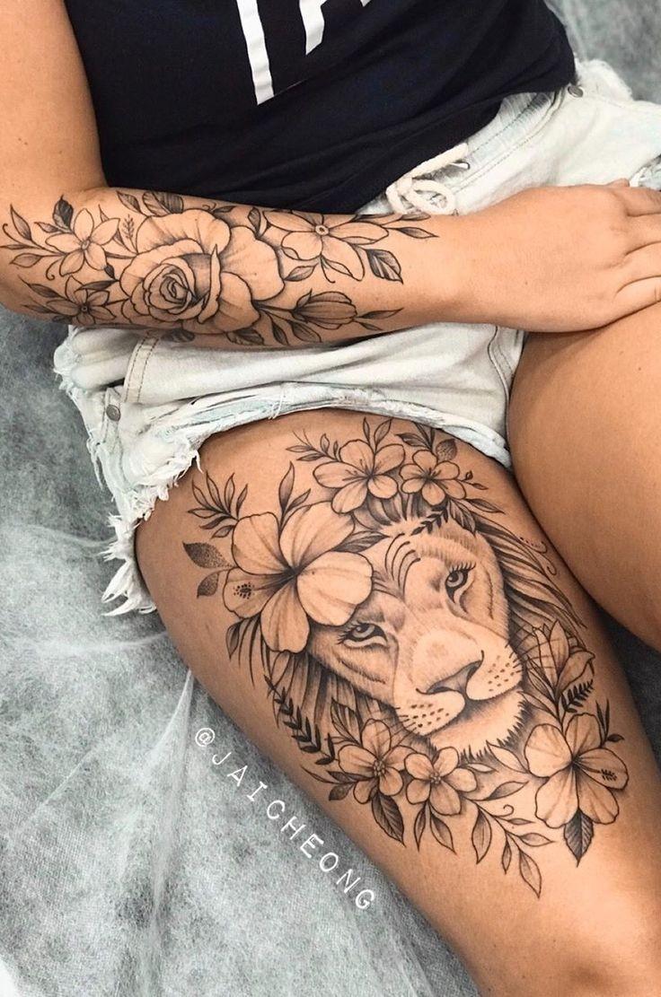 Idées tatouage cuisse femme lion.jpg