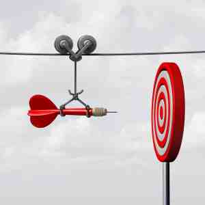 Success hitting target as a business assistance concept with the help of a guide as a symbol for goal achievement management and aim to hit the bull's eye as a dart assured to go straight towards the center.