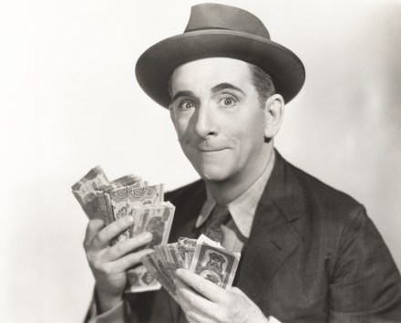 man with dollar bills in his hands