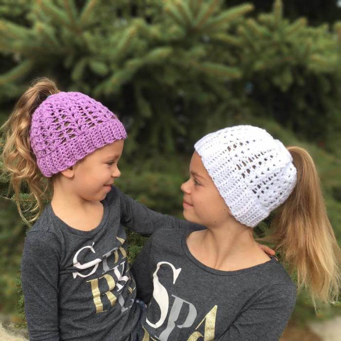 My nieces love their hats made from this free Springtime Ponytail Hat Crochet Pattern! #freecrochetpattern #crochetponytailhat #crochetbunhat #messybunhat #bunbeanie #springbunhat #springcrochet #crochetforkids #freepattern #freeponytailhatpattern #ponytailhatcrochetpattern #crochetpattern #messybunhatcrochetpattern