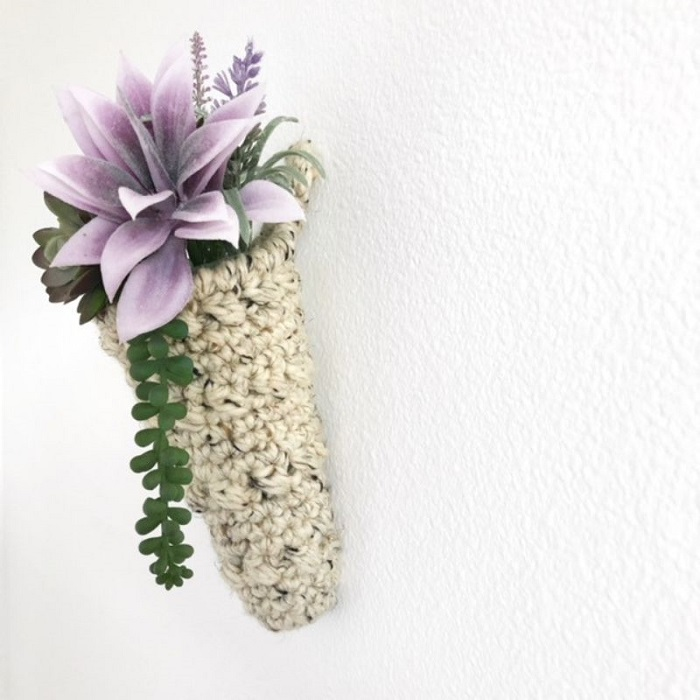 a photo of a cone shaped plant hanger hanging on the wall