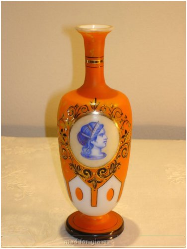 HARRACH ORANGE CASED GLASS VASE WITH ENAMELED PORTRAIT OF ROMAN WOMAN AND GOLD DETAILS