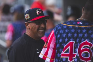 Chihuahuas manager Edwin Rodriguez smiles in the dugout
