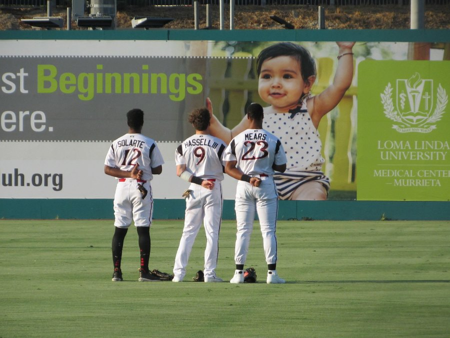 Padres prospects Angel Solarte, Robert Hassell III and Joshua Mears gather for the National Anthem