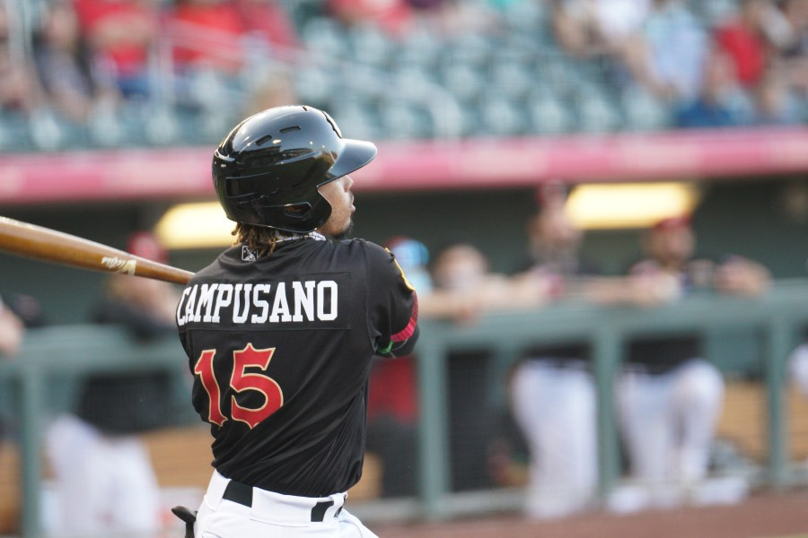 Luis Campusano finishes his swing for the El Paso Chihuahuas