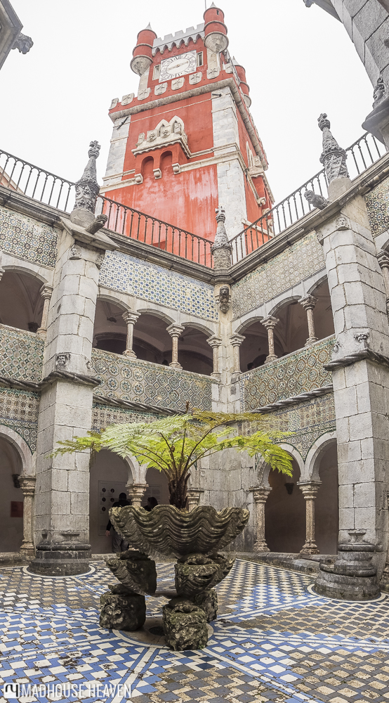 medieval islamic courtyard, raid, blue mosaic tiles, coral pink castle tower, three point perspective