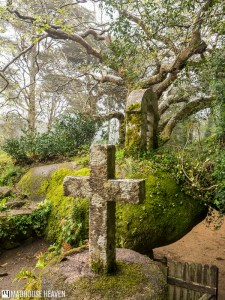 Moss covered stone cross, Convent of the Capuchos, Sintra, Portugal