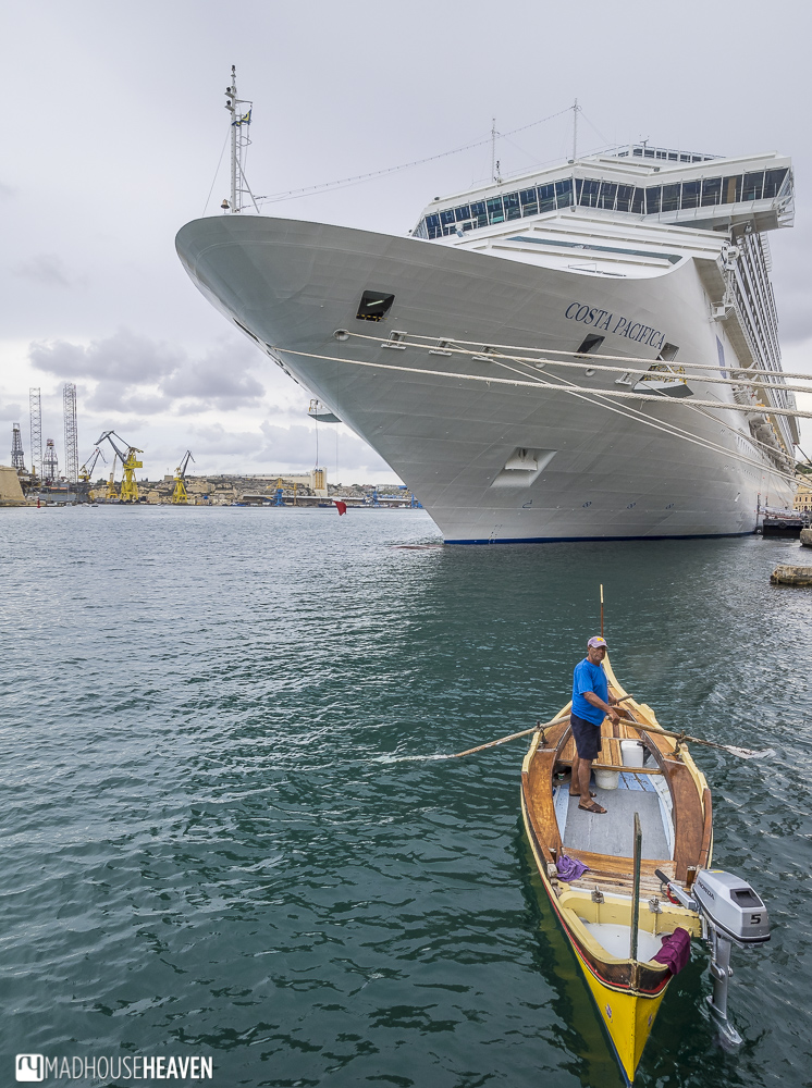 Yellow boat in juxtaposition beside a large cruise liner in Malta. Malta megalithic to modern