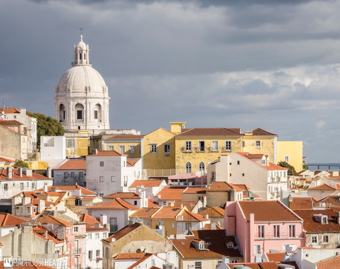 terracotta roofs of tightly packed medieval town in Lisbon, Alfama, part of Lisbon's Architectural History