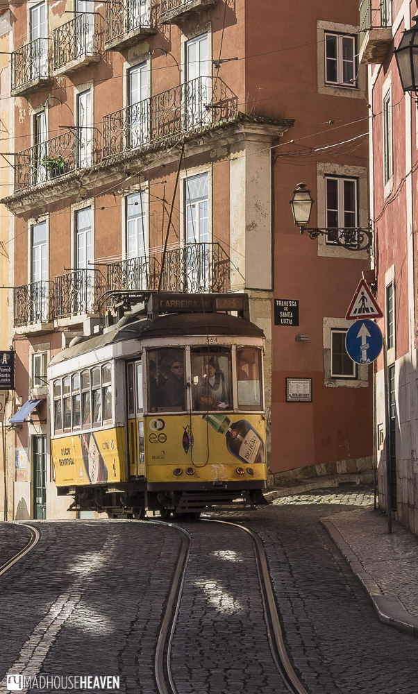 Lisbon's electric tram 28 turning a corner down the city's narrow roads - Lisbon's Architectural Heritage